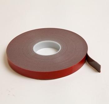 Low surface energy pressure sensitive tape